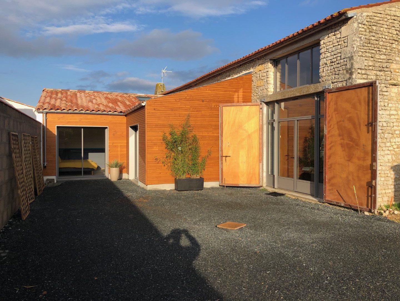 Extension en ossature bois d'une maison en pierre